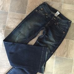 """SALETrue Religion Jean Size 25 Authentic TRUE RELIGION JEANS  I believe are the Bobby Flare Jean.  They are ultra low rise, and flared.  Worn gently, except for wear and fraying at the hems as shown in the pictures.   Original price over 100$ and purchased at Nordstroms.   Own a pair of these great jeans and you will be the envy of all your friends.  Size - 25 Dark Wash, stretch material, zipper fly and 5 pocket styling Measurement across the front at the waist flat - 13 12/"""" Ultra Rise - 7""""…"""