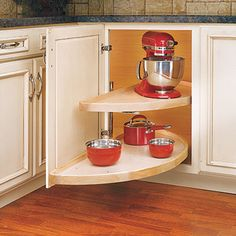 This update of the old reach-in-and-spin organizer has two pivoting half-circle shelves that slide out from the cabinet. Rev-A-Shelf Wood Classic Half Moon Two Shelf Lazy Susan. | Photo: Courtesy of Cabinetparts.com | thisoldhouse.com