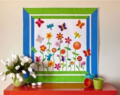Make this gorgeous butterfly applique quilt pattern as a baby quilt, throw quilt, or wall hanging. This cheery Applique Butterfly Garden is a simple way to decorate your home for spring. this mini quilt looks great on your child's bedroom wall.