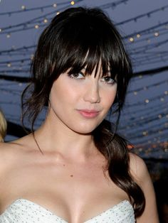 Working her rich, raven locks in a low side ponytail, brunette beauty, Daisy Lowe relies on long layers to frame her face. With a brow-skimming fringe that boasts a piece-y, ruffled texture, try this look on worn-in hair when you don't have time for a blowdry.   - Cosmopolitan.co.uk