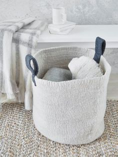 This beautifully crafted light grey felt basket will adorn any space with grace.
