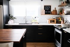 Simple dining room with buffalo check painted wall and black kitchen cabinets #springdecor #simpledecor