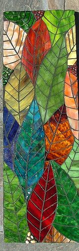 "Leaves | Lynn 7x23"" Stained Glass and glass beads on wood.  This one took the longest of anything I've done.  Around 25 hours.  Decided on black grout after looking at other things I did with the same colors.  If I can't find a nice home for this one, It'll go in the living room."