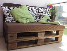 Sofa made of wooden pallets. Need to find these!