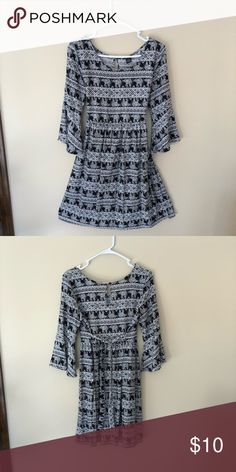 Black and white elephant dress Long bell sleeves with fabric tie in the back. Never worn! Dresses Mini