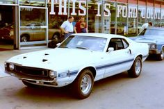 Mike Ashland sent this to Growing OLD on the Internet on Fb.  This is a Ford Dealership photo from the latter part of 1969, and there is a 1970 Maverick in the Showroom.  I still prefer MUSTANGS over all other American muscle cars.