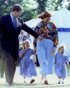 Duke and Duchess of York, pictured with their children Princess Beatrice [C] and Princess Eugenie in May 1992