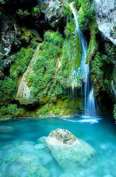 Water falls from Urederra River,Spian