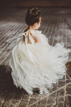 What a sweet idea for a flower girl dress! | Photo: Studio 29