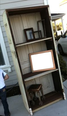 (use a varient of this to make a wardrobe) 20 Simple and Creative Ideas Of How To Reuse Old Doors - Old Door Bookshelf
