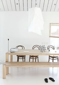 white lamp and wood dining table