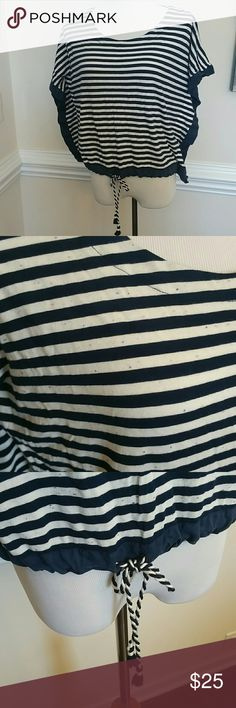 Vineyard Vines top Vineyard Vines top.  Ivory with navy strip. Tiny colorful dots in background.  Navy trim is synthetic silky fabric.   EUC. Perfect addition to summer wardrobe! Vineyard Vines  Tops