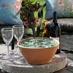 Tabletop Fire Pit- DIY put a 13 oz can of clean-burning gel alcohol fuel in an inflammable pot and surround can with recycled glass or stones