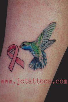 breast cancer ribbon and hummingbird tattoo. Love this!!!