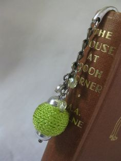 silver toned metal bookmark with fabric bead by Trudysbeads