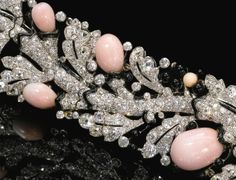 Detail: Art Deco diamond, conch pearl, and enamel bracelet by Cartier. Circa late 1920s. Via Diamonds in the Library.