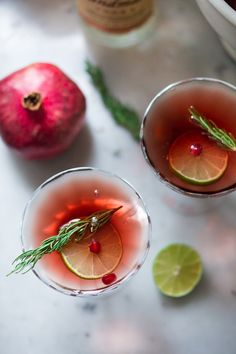 A simple recipe for a Pomegranate Drop with Rosemary ...a refreshing and festive holiday cocktail.   www.feastingathome.com