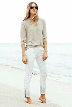 Casual tan shirt with white skinny jeans.