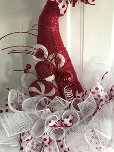 A personal favorite from my Etsy shop https://www.etsy.com/listing/562338647/christmas-candy-santa-hat-deco-mesh