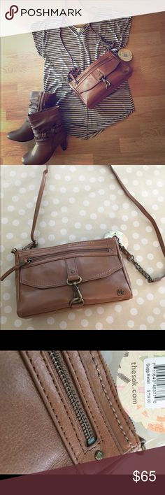 Brown leather purse Soft brown leather bag that looks great with essentials and makes a perfect every day style👜 includes adjustable strap and chain detail The Sak Bags Shoulder Bags