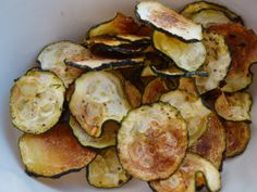 Zucchini Chips. Just made these. Not as crispy as I would have thought, but still good. I added Sirachia sauce (of course). Worth another try.