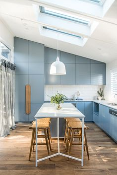 A light filled blue and white kitchen.