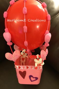 Valentine's Day Hot Air Balloon using supplies from Dollar Tree. I added my Rainbow Loom Valentine's Day Puppy's.
