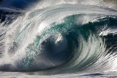 Photographer Pierre Carreau captures waves mid-break, showing the surf's delicate balance of power and fragility