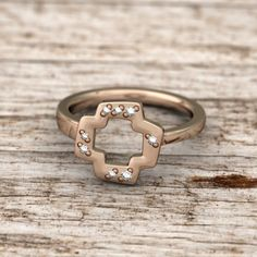 The Quaintrelle Open Plus Ring with Accent Pave is a beautiful open form ring is based on the classic plus shape. Ring is designed to be asymmetrical and slimmer on one side to allow for interlocking and stacking of multiple rings.