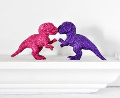 Baby T-Rex Dinosaurs in Fuchsia Hot Pink, Grape Purple Glitter Baby Shower Table Settings, Girly Girl Nursery Decor or Fun Home Decorations. $36.00, via Etsy.