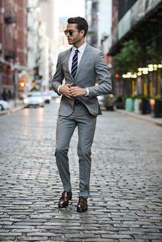 Classic Modern mens fashion - Grey suit and striped tie!