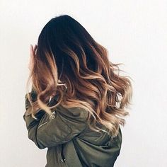 Gorgeous long hair with waves and a balyage ombre effect color chestnut with golden