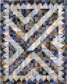 """Riverbed, an original Log Cabin quilt- Piece 'n' Play Quilts, 2002. Designed and pieced by Judy Martin. Hand-quilted by Eleanor Wyckoff. 72"""" x 90"""". The set is free form and asymmetrical."""