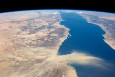 This astronaut photograph provides a panoramic view of most of the length of the Red Sea. The northernmost end, the Gulf of Suez, is just visible at the top center of the image and is fully 1,900 kilometers (1,200 miles) in ground distance from the International Space Station (ISS).