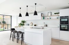 This dreamy white kitchen provides a modern, clean and minimalistic feel for your home.  Kitchen by Elan Kitchens - London 55 New King's Road, London, SW6 4SE www.elankitchens.co.uk Kitchen Post, Kitchen Ideas, I Love House, Fulham, House Extensions, Minimalist, London, Modern Kitchens, Table