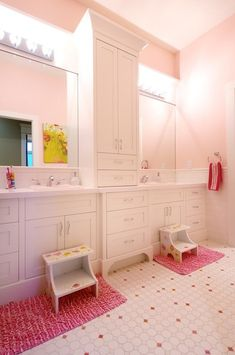 jack n jill bathroom-- disregard the pink. like cabinet idea