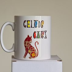 Celtic Cat Mug in Red by WEatonMedievalArts on Etsy Cat Mug, Craft Items, Your Design, Celtic, Invitations, Mugs, Unique Jewelry, Handmade Gifts, Artwork