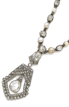 A pearl and diamond pendent necklace, circa 1920 The detachable openwork pendant millegrain-set throughout with rose-cut diamonds, centrally collet-set with a pear-shaped rose-cut diamond, with an oval-shaped rose-cut diamond surmount, suspended from a necklace set with alternating 4.0mm-6.2mm pearls of various tints and rose-cut diamonds, to a box-link backchain, necklace convertible to a bracelet, lengths: pendant 5.3cm, necklace 47.6cm, fitted case