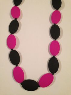 Pink/Black teething necklace.  $30 or 2 for $50 www.facebook.com/hootsybaby