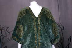 Mariano Fortuny Green Stencilled Velvet Long Coat image 8The hand stenciling is done with real gold metallic pigments aged to a mellow, burnished color. Fortuny built his stenciled pieces layer upon layer, until he achieved the effect of an ancient brocade.