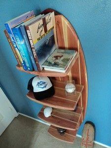 Surfboard bookshelf from bettersurfthansorry.com