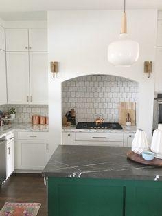 Ceramic Elephant Designs, emerald green cabinets, green island, black marble, honey comb backsplash, west elm pendant, sconces in kitchen, copper accents