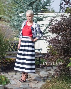 It's your holiday soirée outfit, darlings. • {Red blouse, striped skirt, and fabulous heels are all listed!}