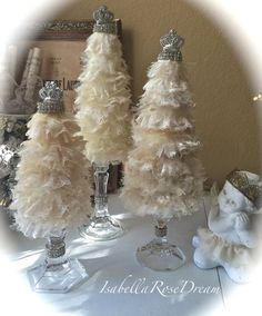 PLEASE READ FULL DESCRIPTION BEFORE PLACING AN ORDER!!! Set of 3 (two L and one S) beautiful, Christmas tree topiary, decorated with combination of lace and tulle in different shades of soft cream color. The tops of each tree decorated with beautiful rhinestones as well as a middle of glass bases. These trees will be absolutely lovely in any room as a decor for Christmas or all year around. I am offering a several options: 1. If you prefer to keep bases separated and use them in a differe...