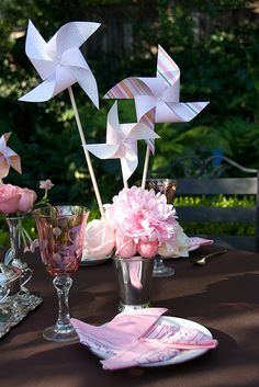 baby girl shower centerpiece idea without the pin wheel. simple cute flower arrangements
