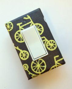 Bicycle Light Switch Plate Cover / Rocker Decora / Citron Bikes / Kids Room / Baby Nursery / Yellow and Gray by Michael Miller. $8.00, via Etsy.