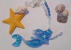 Mermaid in blue mylar flakes in resin