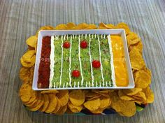 Superbowl dip - this looks easy enough even I could do it :) Just plate some salsa, guacamole, and some melted cheese or queso dip and line with sour cream.