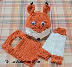 Three piece pattern knitted in soft Berroco Comfort yarn, Pumpkin and White, consisting of fox hat, over-the-head bib in preemie and term sizes, and coordinating leg warmers for each of five sizes: Medium Preemie (3-5 lbs), Large Preemie/Newborn, 6 months, 1 year, and toddler (2-3 years).