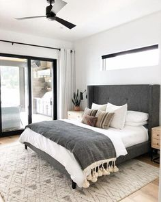 A modern take on traditional, this eye-catching grey tufted headboard is the star of the show. Make sure to balance out any dominating features of a bedroom with your bedding choices. Cozy Bedroom, White Bedroom, Home Decor Bedroom, Bedroom Furniture, Master Bedroom, Bedroom Ideas, Bedroom Designs, Master Suite, Bedroom Wardrobe